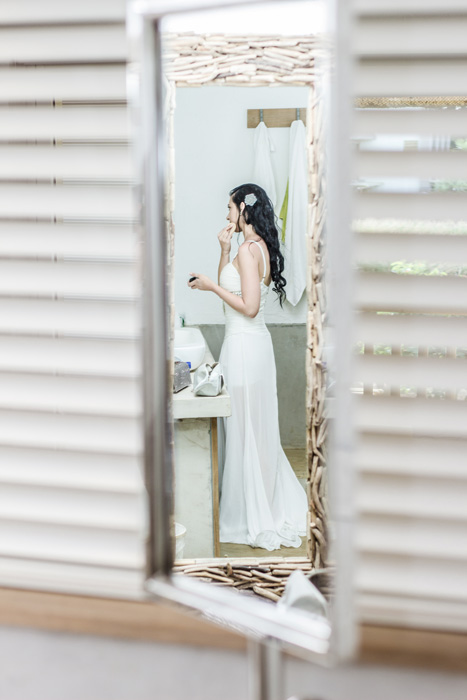 Bride getting dress mirror